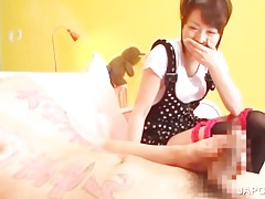 Asian cutie gives handjob close by sexgames
